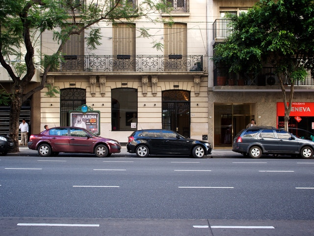 Cars parked on the street at Recoleta.