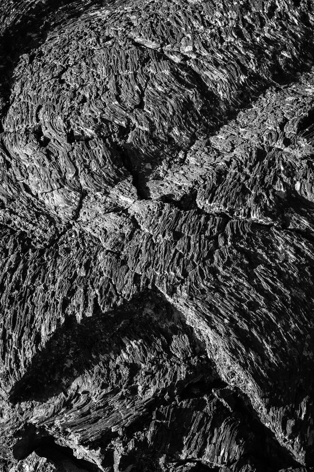 Detail of pahoehoe lava along the Cave Area trail. The lava looks rough and jagged, but ropey and wavy.