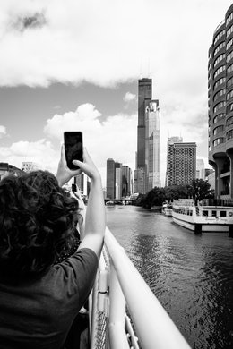 Kat, taking a photo of Sears Tower from the tour boat.