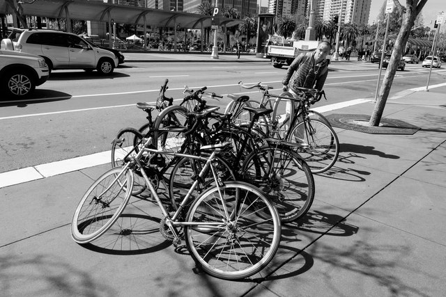 A pile of bikes chained to a bike rack at the Embarcadero, San Francisco.