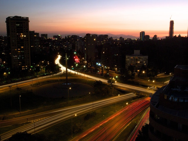 Santiago at dusk, with the Costanera Norte and Américo Vespucio avenue seen from the top of the Hotel Kennedy.