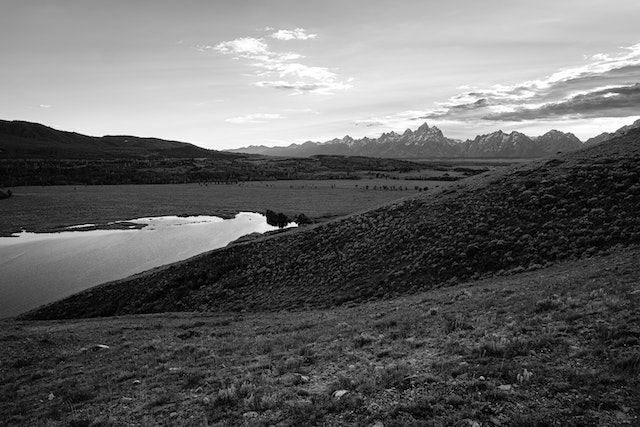 View of Elk Ranch Flats and the Elk Ranch Reservoir from Uhl Hill, with the Teton range in the background.