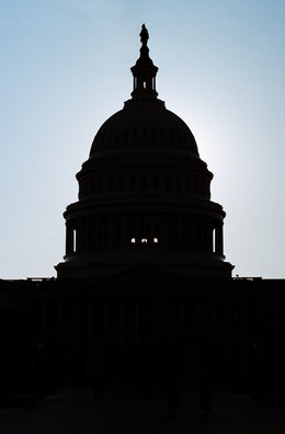 Silhouette of the United States Capitol, at sunset.