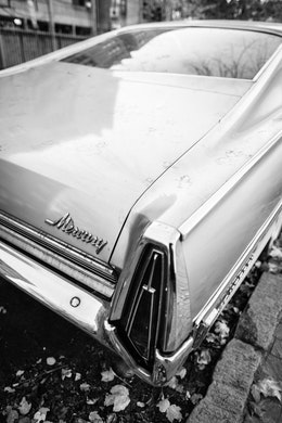 "The ""Mercury"" badge on the rear end of a 1968 Mercury Monterey parked on G Street SE in Washington, DC."