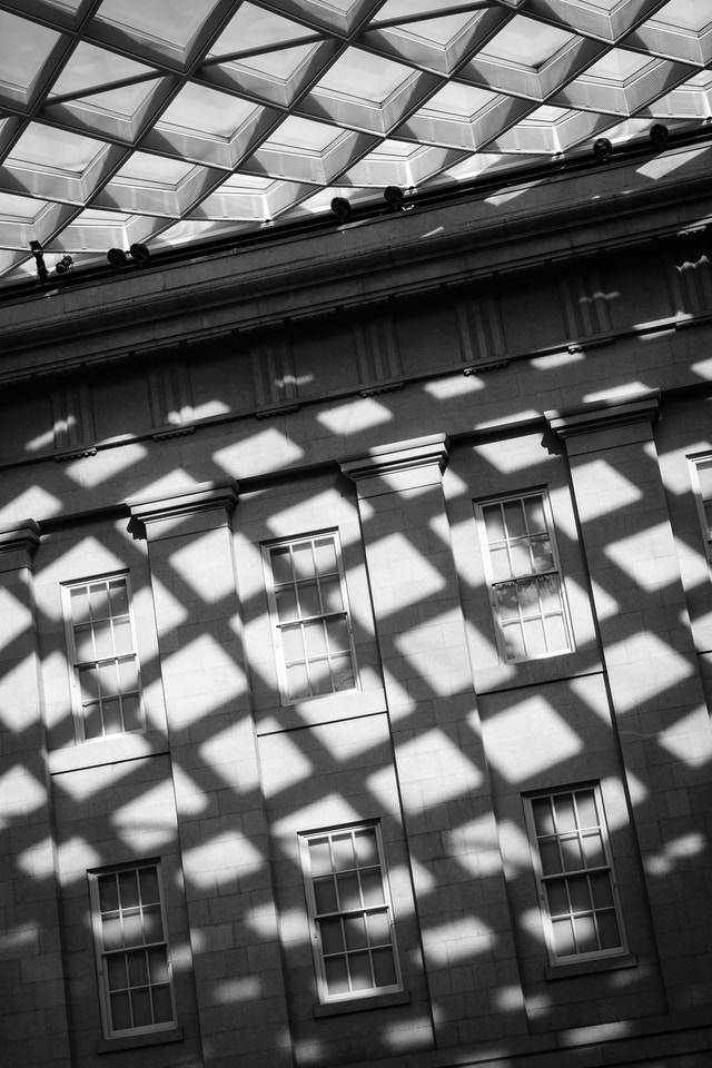A shadow cast by the roof of the National Portrait Gallery on an inner wall of the Kogod Courtyard.
