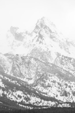 Close-up of Grand Teton shrouded in clouds.