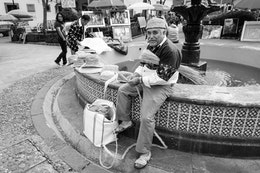 A man making straw hats at Plaza del Carmen, in Mexico City.