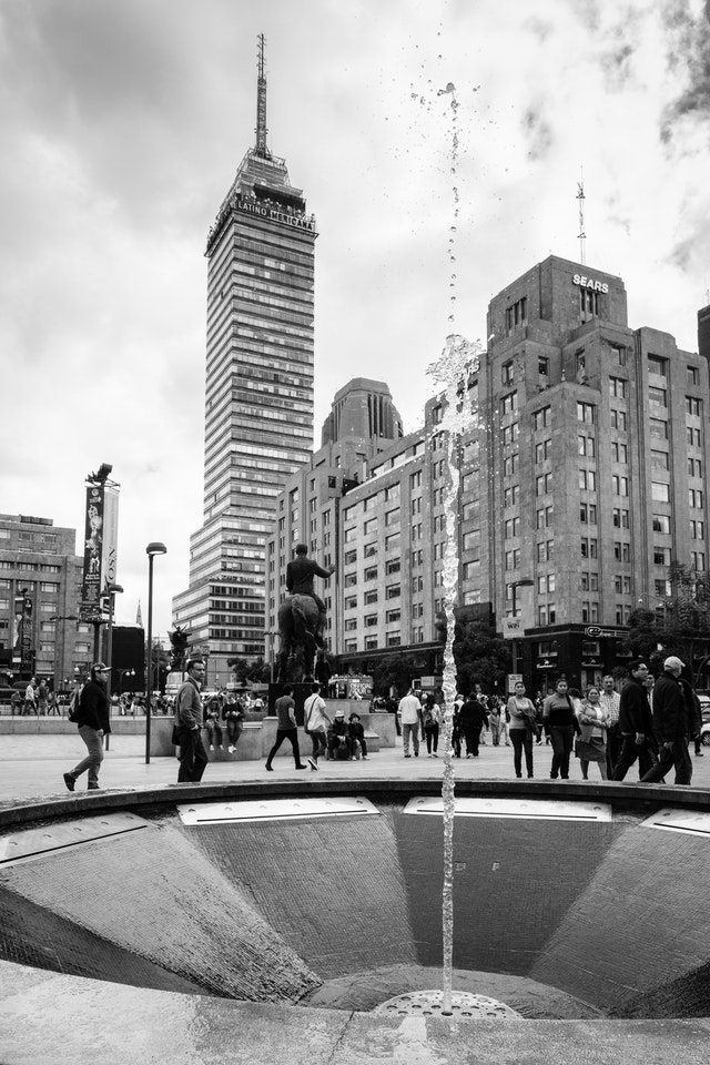 A fountain near the Alameda Central, with the Torre Latinoamericana in the background.