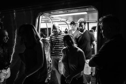 People exiting a DC Metro train at Metro Center.