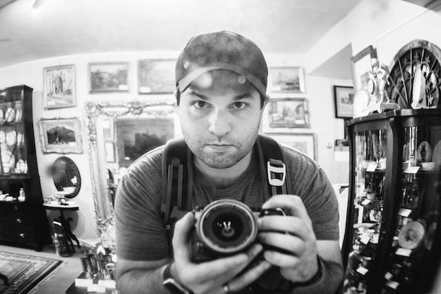 Self-portrait of myself in front of a mirror at an antique shop.