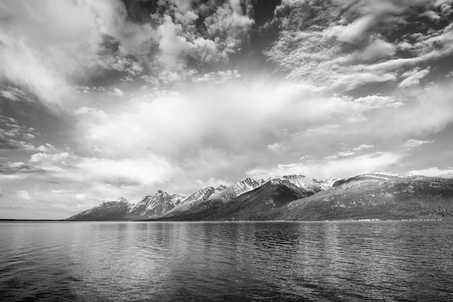 The Teton range under dramatic morning clouds at the Jackson Lake Overlook.