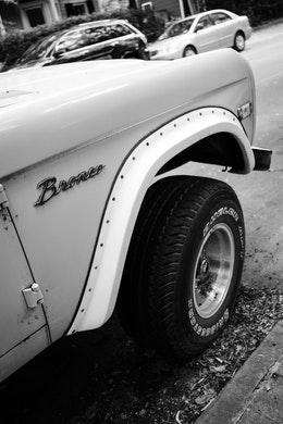 The badge on the front right side of a classic Ford Bronco in Capitol Hill.