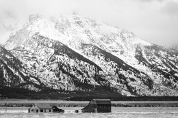 The Reed Moulton Barn with the snow-covered Tetons in the background.