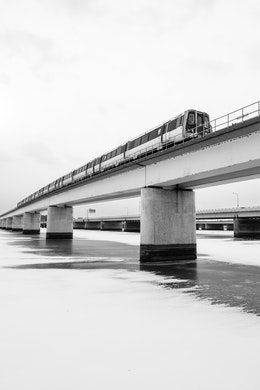 A yellow line Metro train crossing the frozen Potomac river.