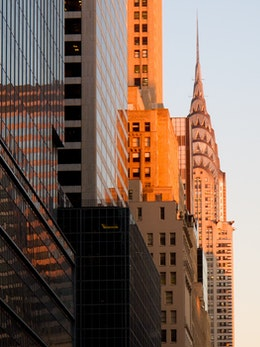 The Chrysler Building, bathed in lovely golden hours colors, taken near the corner of 7th Ave. & W 42nd St.