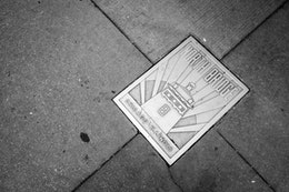 """A """"North Bridge"""" plaque on the street in Chicago."""