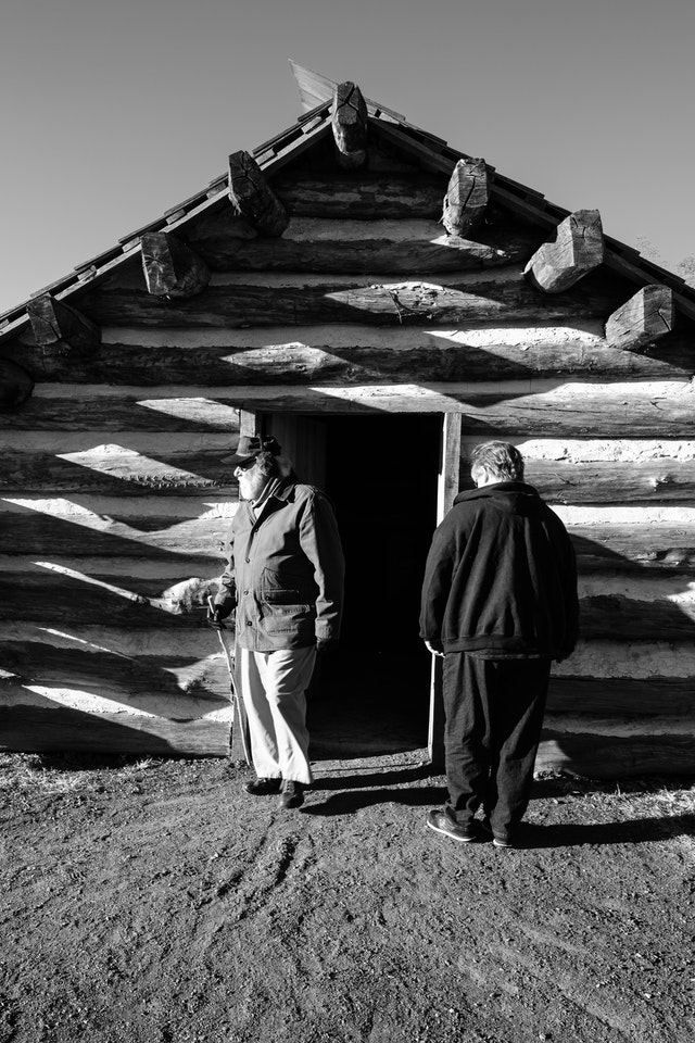 Visitors observing a soldier's cabin at Muhlenberg's Brigade in Valley Forge.