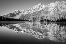 The Tetons, reflected in the misty waters of String Lake. From left to right, Teewinot Mountain, Grand Teton, Symmetry Spire, Mount Saint John, and Rockchuck Peak.