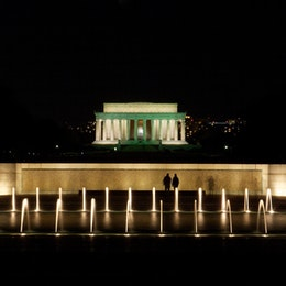 The National World War II Memorial, with the Lincoln Memorial in the background.