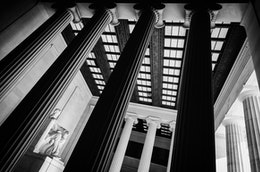 Black & white view of the inside of the Lincoln Memorial in Washington, DC.