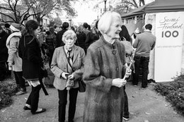 Two ladies walking through a Finnish tourism festival in Dupont Circle.
