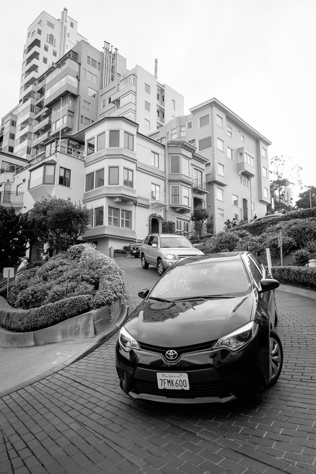Cars twisting and turning down Lombard Street, San Francisco.
