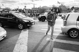 A man crossing the street in downtown Annapolis, Maryland.