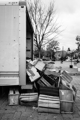 Boxes and crates spilling out of a truck at Eastern Market.