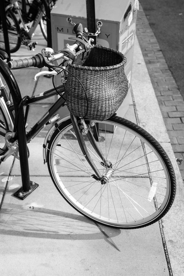 A bicycle with a wicker basket on 14th Street.
