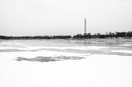 The Washington Monument, seen across the frozen Tidal Basin from the Jefferson Memorial.