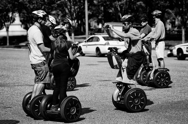Tourists on Segways posing for photos at the White House.