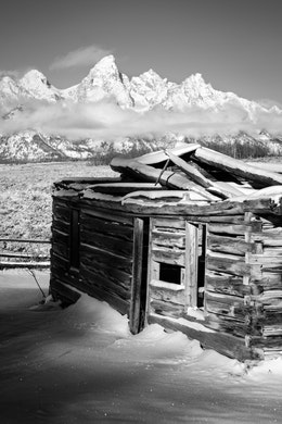 The Shane Cabin at Grand Teton National Park, with the Tetons in the background.