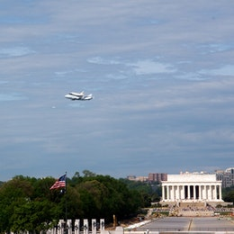 Discovery, flying over the Lincoln Memorial atop the Shuttle Carrier Aircraft.