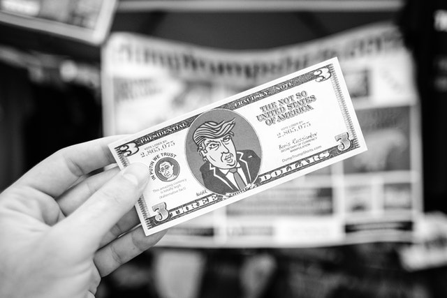 A fake three dollar bill with Trump's face on it.