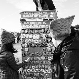 Women looking at buttons for sale at the Women's March in Washington, DC.