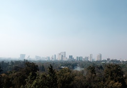 The skyline of Mexico City from the top of Chapultepec Hill on a very hazy day.