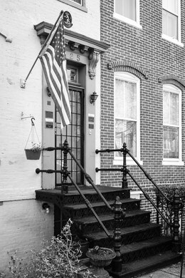 A flag next to a door in a Capitol Hill rowhouse.