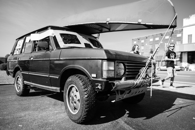 A Range Rover with eclipse glasses on the windshield, at Starr Mountain Outfitters in Etowah, Tennessee.
