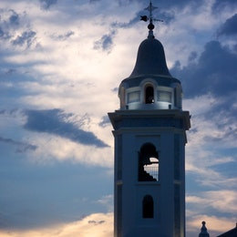 Bell tower of the Church of Nuestra Señora del Pilar, at dusk.