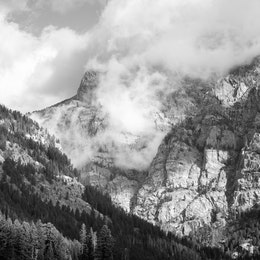 The rocky walls of Death Canyon, surrounded by clouds.