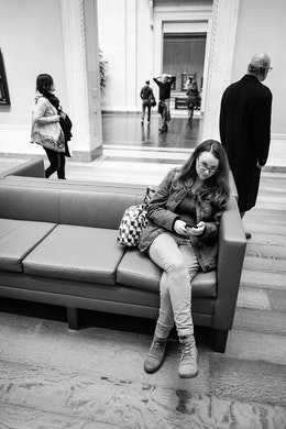 Kate, sitting on a bench at the National Gallery of Art.