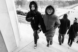 Two women climbing the stairs of the Lincoln Memorial.
