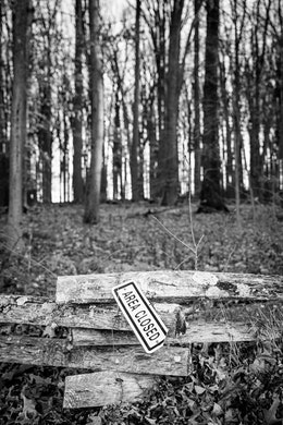 """A fence at Valley Forge, with an """"area closed"""" sign hanging from it."""