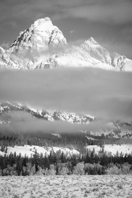 Grand Teton, seen half-covered in clouds at Grand Teton National Park.