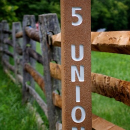 """A post inscribed with """"5 Union"""" at Antietam National Battlefield."""