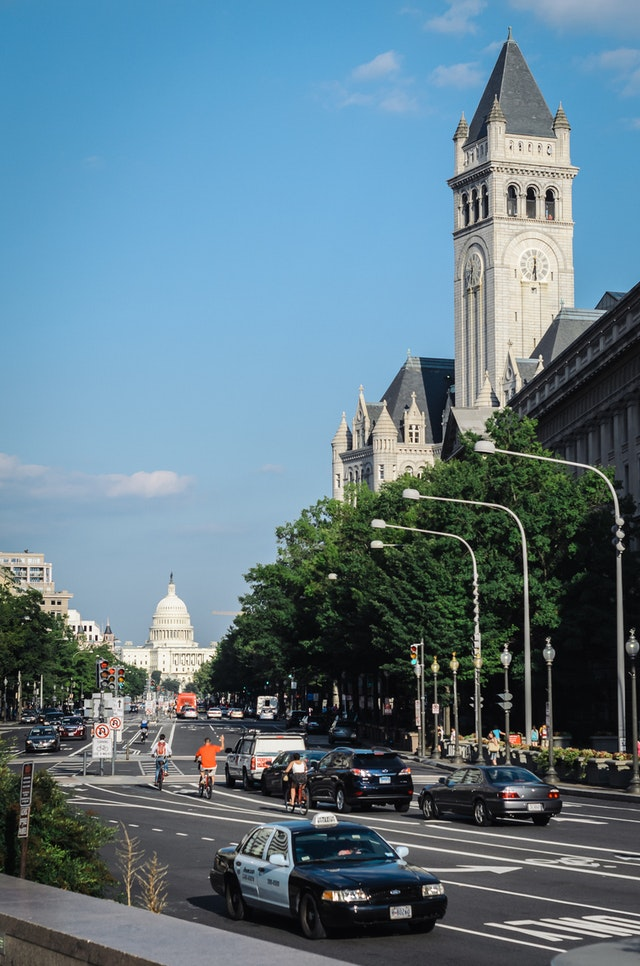 View of Pennsylvania Avenue, the Old Post Office, and the United States Capitol, from Freedom Plaza in Washington, DC.