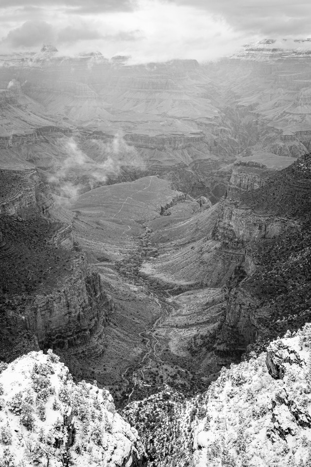 The Bright Angel Trail, seen from the South Rim at Grand Canyon Village during a retreating snowstorm.