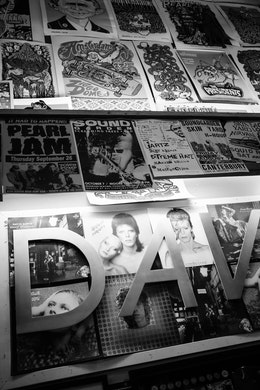Concert & album posters for Pearl Jam, Soundgarden, David Bowie, and others, on a wall at Easy Street Records in Seattle.