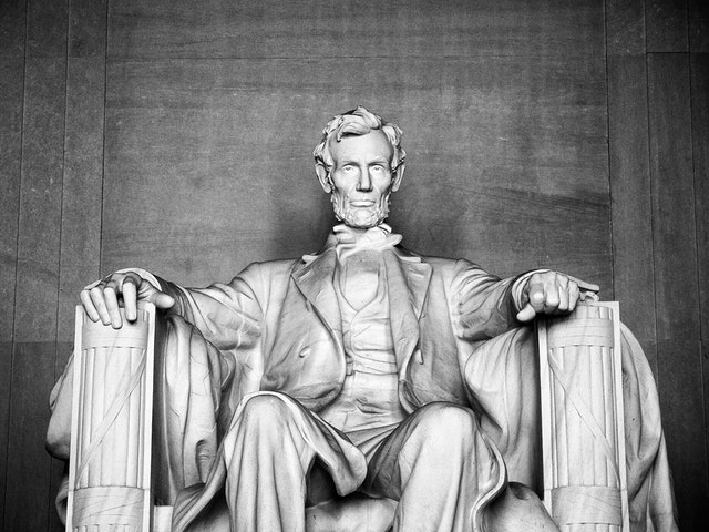 Abraham Lincoln at the Lincoln Memorial.