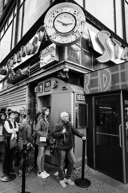 People waiting in line outside Ellen's Stardust Diner in New York City.